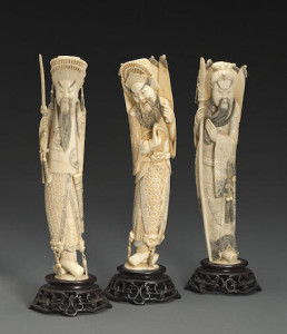A group of three carved and tinted ivory martial figures
