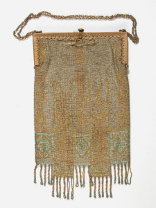 Hand bag - Rectangular beaded hand bag (evening) in silver gold and green small glass beads. Twisted bead fringe. Gilt frame and chain. Label inside brown sateen lining 'Jean Lindsay, 22 Nanking Road, Shanghai'. 1920 (circa)